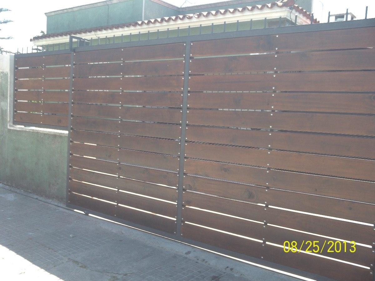 Pin portones de chapa levadizos corredizos pelautscom on for Portones de madera y hierro